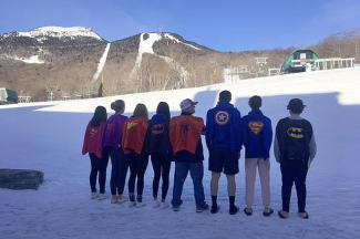 St. Lawrence College from the UK rocking their super hero capes in honor of silly moments during their ski week.